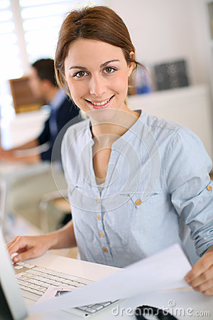 Cheerful girl in computer training