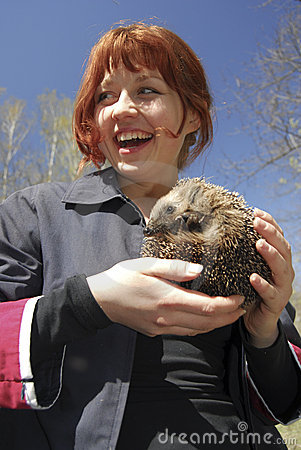 Cheerful girl with hedgehog