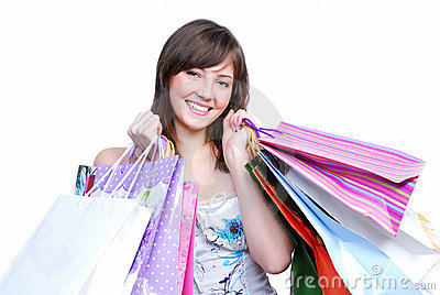Cheerful girl holding colored bags