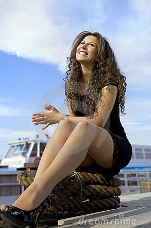 Cheerful girl on landing stage