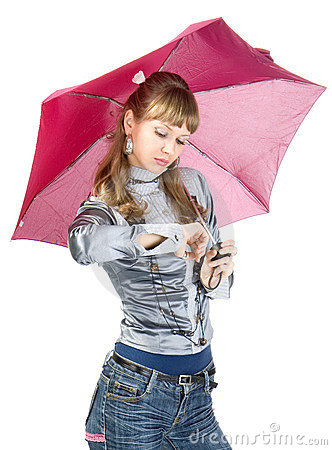 The cheerful girl   with a pink umbrella