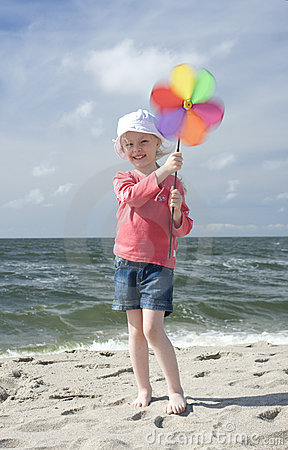Cheerful girl with pinwheel