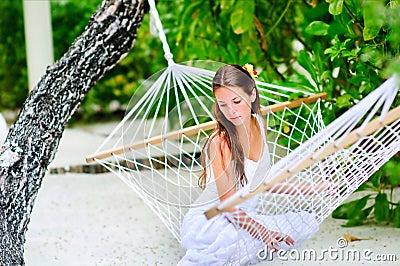 Cheerful girl relaxing in hammock