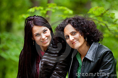 Cheerful girlfriends outdoor