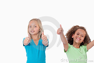 Cheerful girls with the thumbs up
