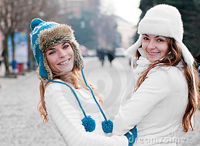 Cheerful girls twins, in the street