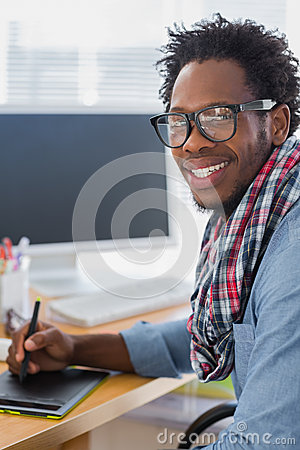 Cheerful graphic designer using a graphics tablet