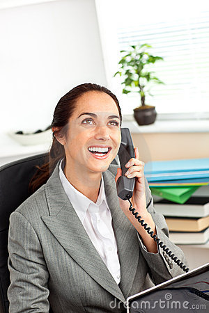 Cheerful hispanic businesswoman talking on phone