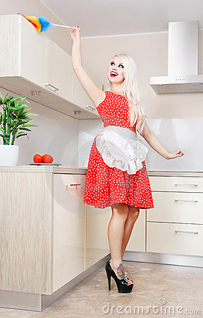 Cheerful housewife in the kitchen