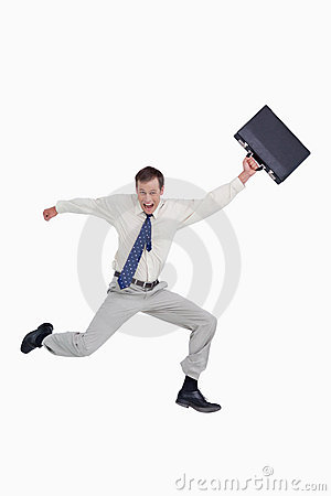 Cheerful jumping businessman with his suitcase