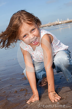 Cheerful kid at the beach