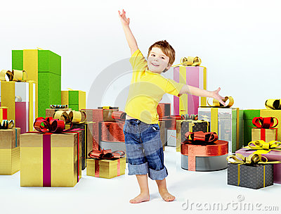 Cheerful kid with lots of presents