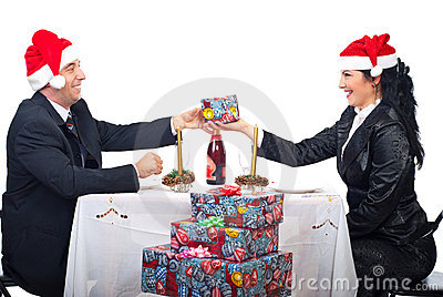 Cheerful laughing couple at Christmas table