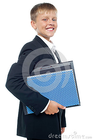 Cheerful little boy holding business files