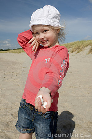 Cheerful little girl with cockle-shell