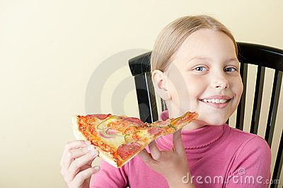 Cheerful little girl with pizza