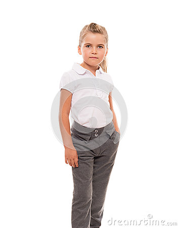Cheerful little girl wearing white t shirt and pants isolated on