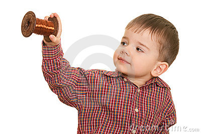 Cheerful little kid holding a roll of cooper wire