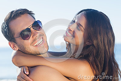 Cheerful loving couple hugging each other