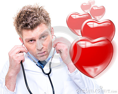 Cheerful male doctor listening heartbeat