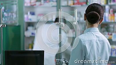 Cheerful male pharmacist reading prescription stock footage