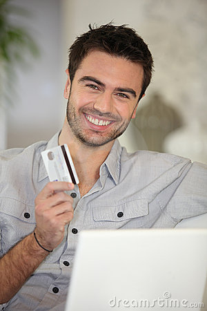 Cheerful man with credit card