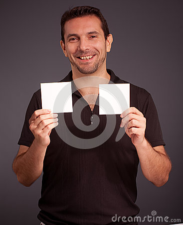 Cheerful man holding two blank cards
