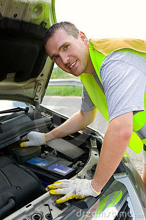 Free Cheerful Man Mechanic And A Car Stock Photography - 5891092