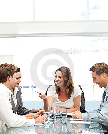 Cheerful manager talking to her team