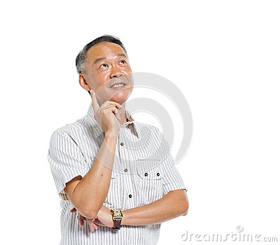 Cheerful Mature Asian Man Thinking Stock Photo