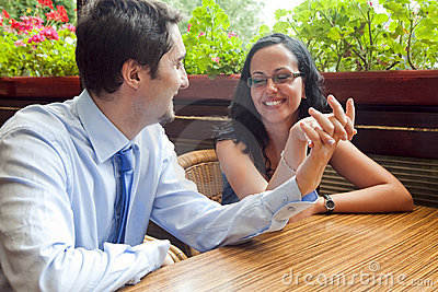 Cheerful pretty couple at restaurant table