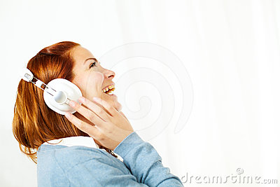 Cheerful pretty woman listening to music