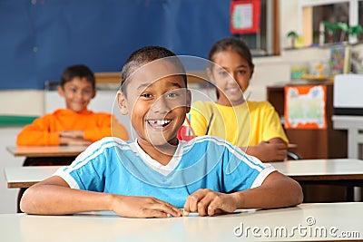 Cheerful primary school children in classroom