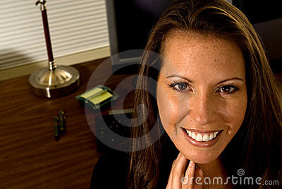 Cheerful Professional Woman at Desk