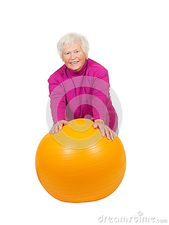 Cheerful retired lady with a pilates ball