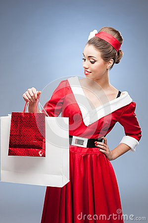 Cheerful retro girl holding shopping bags