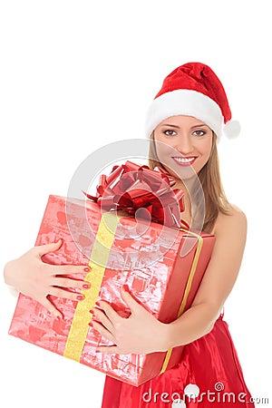 Cheerful santa helper girl with big gift box