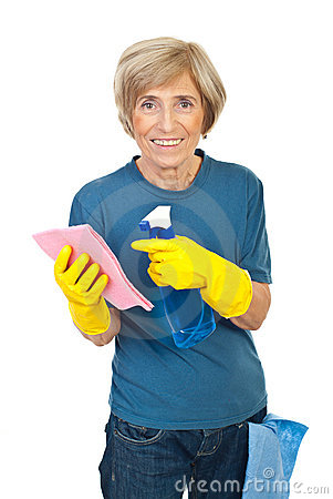 Cheerful senior cleaning house