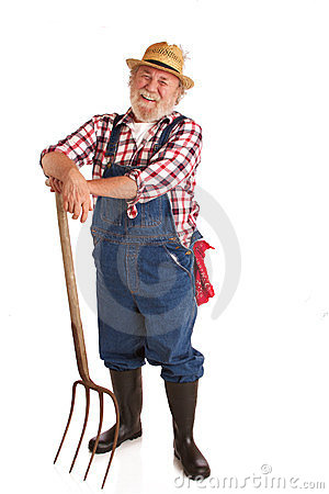 Free Cheerful Senior Farmer Leaning On Hay Fork Royalty Free Stock Photo - 23681855