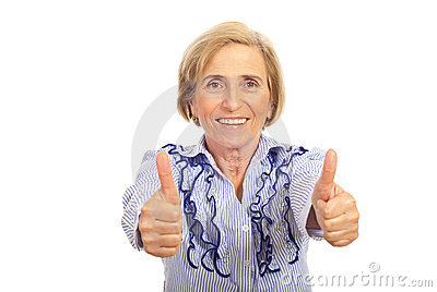 Cheerful senior woman giving thumbs up