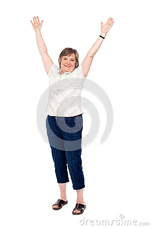 Cheerful senior woman lifting her arms up