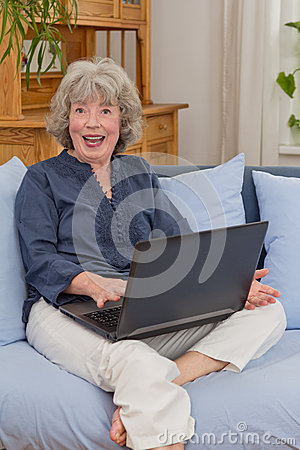 Cheerful senior woman with notebook