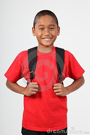 Cheerful smile from young boy 9 wearing school bac
