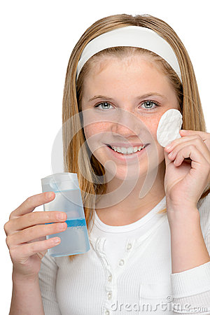 Cheerful smiling girl removing cleaning make-up fa