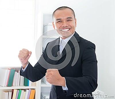Cheerful Southeast Asian businessman