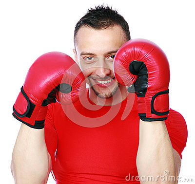 Cheerful sportsman in boxing gloves