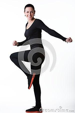 Happy smiling woman doing aerobics