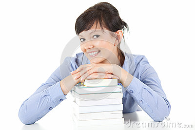 Cheerful student woman leaning on pile of books