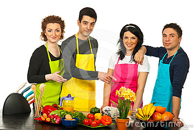 Cheerful team of chefs pointing
