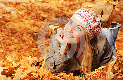 Cheerful teen on fall foliage